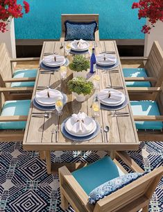 Wide-plank geometric angles and clean lines mark the modern St. Kitts Dining collection. The rectangular table commands any space it occupies with a weathered gray finish that convincingly feigns age. Slatted back chairs have broad sturdy arms and all-weather cushions.