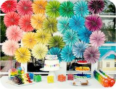 rainbow party rosettes plus colorful fruit skewers.