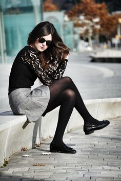 Black tights, grey pleated skirt and top with lace sleeves
