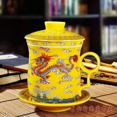 Ufingo-Yellow Chinese Dragon Bone China Tea Cup With Lid And Saucer And Filter Tea cup by Ufingo http://www.amazon.com/dp/B00CSDJ1P2/ref=cm_sw_r_pi_dp_5Rz1tb0CB3SVZNGT