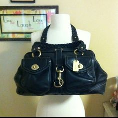 COACH LEGACY BLACK LEATHER LARGE handbag Price reduced and firm   Large Coach Legacy collection black leather bag.Bronzed hardware ,braided handles and technology pockets Authentic. Gorgeous condition no rips or stains outside inside a few pen marks and just normal wear no tears inside. Very beautiful bag. Coach Bags Satchels