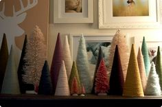 How fun would a mantel of trees be for the holidays!  Both yarn and bottle brush! Love, love, love!