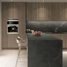 STORM iTOPKer is inspired by the dynamism and beauty of natural stone. A new version of a classic in dark grey with white veins, this solid surface evokes nature at its most vigorous in a contrasting gentle natural finish.