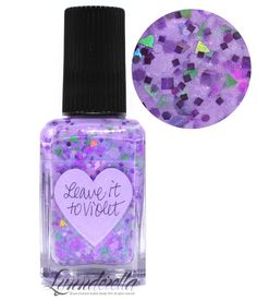 "Lynnderella Limited Edition—Leave it to Violet contains assorted violet holographic, metallic and satin glitters accented with pink-violet holographics and green holographic triangular ""leaves"". Translucent mid-violet base with blue and violet shimmer."