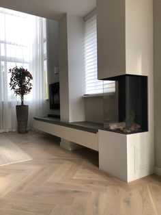 Adding vertical lines to connect the fireplace with the tv. If minimal brutalist architecture exist, this might be it. Decor, Tv Cabinets, Cabinet, Minimalism, Home Decor, Fireplace