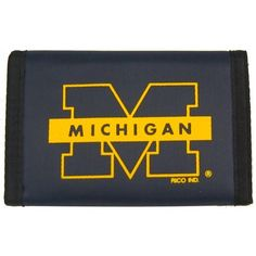 Michigan Nylon Wallet by Rico. $7.85. Keep your money and valuables in this classic surf style nylon wallet. Feature money compartment, three inner compartments, three photo sleeves, hook and loop fastener closure.