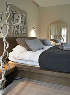 soft neutrals, linen bedding, nature as sculpture in the bedroom