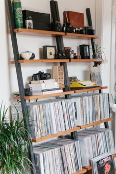 Impressive Bookshelf Record Collection Vinyl, The records instde the shop now all have poly sleeves and high rates, and you may get some decent records here. If you take a close look at a vinyl re. Vinyl Record Storage Shelf, Storage Shelves, Ladder Shelves, Vinyl Record Display, Shelving, Chicago Apartment, Leaning Bookshelf, Bedroom Bookshelf, Vinyl Record Collection