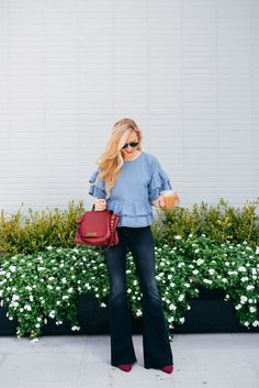 5 Things To Know About This Weekend! | A Pinch of Lovely | Southern Fashion & Style Blog. Light blue ruffle top+flare jeans+raspberry pumps+red handbag+sunglasses. Late Summer Outfit 2016