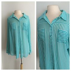 """Torrid button down Torrid striped blouse (teal/ white). Torrid Size 2 (2x). Measures 30"""" long with a 48"""" bust. 100% polyester. Lightweight and sheer. Great for spring and summer! Two front pockets and buttons on the cuffs. Adorable button detailing on the back EUC. No trades. Poshmark onlyI am very open to fair offers! torrid Tops Button Down Shirts"""