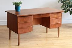 Mid-Century Modern/Danish Modern teakwood desk.  Just imported from Denmark.   Features a finished back and extra deep drawers.  Gorgeous teak wood...