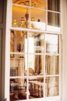 Looking through multi-paned windows at the cozy interior decor....