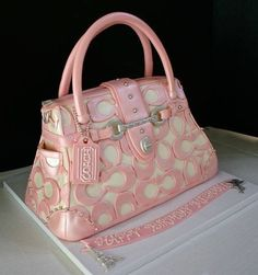 Pink and white Coach Purse Cake.looks yummy