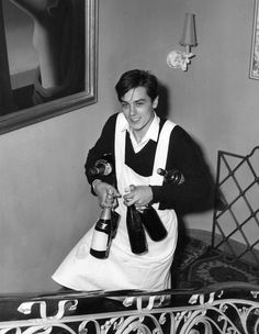 Alan Delon carting champagne