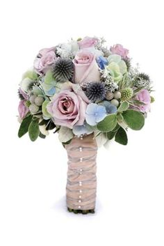 lovely textural bouquet also with 'silverstone' lavender roses, 'ocean song' lavender roses, echinops (the bristle-y blue balls), hydrangea, brunia (the silver grey balls), kochia (the silvery grey little starshaped clusters) and senecio (the silvery green leaves). Ballet-laced stem wrap.