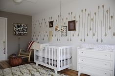 Gender Neutral Arrow Nursery - Love that wall! This would look great with Caden Lane's Gray and White Arrow crib bedding.