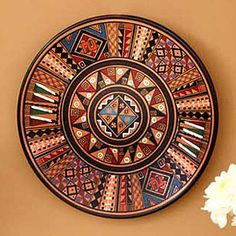 """Inca Star Cuzco Plate for Novica. Huaman Paucar Family says, """"Our clay pieces are molded both on an old-fashioned potter's wheel and by hand. Our art represents the history and customs of our village and its religious beliefs."""""""