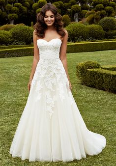 A classic A-line silhouette with a dreamy, voluminous tulle skirt and sweetheart neckline. Pearl buttons and corded lace with scattered sequins and beading provide the lovely finishing touches.