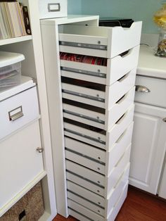 Love the idea of large cabinets for closed storage in between ...