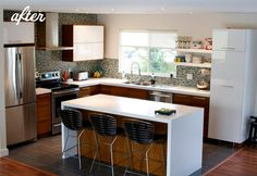 Things I love: open shelving, white uppers & dark lower cabinets, tile backsplash, island counter top that extends down the side, stainless steel appliances. This could be the ultimate kitchen inspiration for me. http://www.designspongeonline.com/2011/04/before-after-two-kitchen-renovations.html