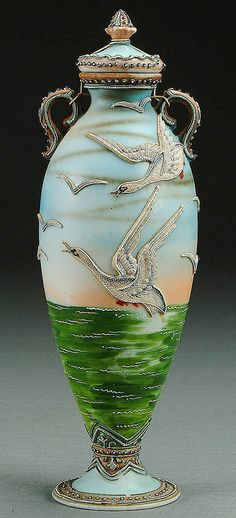 A NIPPON MORIAGE SNOW GEESE DECORATED PORCELAIN COVERED URN CIRCA 1915 WITH MORIAGE DECORATED GEESE FLYING ABOVE A GREEN SEA