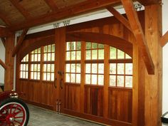 Spanish cedar rolling interior carriage doors by M.S. Herman & Company.