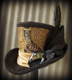 Alice in Wonderland Mini Top Hat, Renaissance, Steampunk, Bridal Facinator, Easter Hat, Tiny Top Hat, Tea Party Hat, Mad Hatter Hat. $42.00, via Etsy.