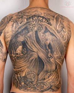 Black and grey grim reaper back tattoo.