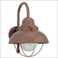 Sea Gull Lighting Sebring H Weathered Copper Medium Base Outdoor Wall Light at Lowe's. The Sea Gull Lighting Sebring one light outdoor wall fixture in weathered copper creates a warm and inviting welcome presentation for your home's Outdoor Barn Lighting, Outdoor Light Fixtures, Outdoor Wall Lantern, Outdoor Wall Sconce, Outdoor Walls, Home Lighting, Lighting Ideas, Rustic Outdoor, Exterior Lighting