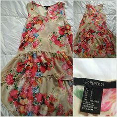 Floral Blouse -junior's Beautiful flowy top that goes perfectly with any bottoms. The back falls longer than the front, don't mistake this for a dress! Sleeveless and scoop neck. Tan with bright floral print. Perfect  condition. Trendy and cute. Forever 21 Tops Blouses