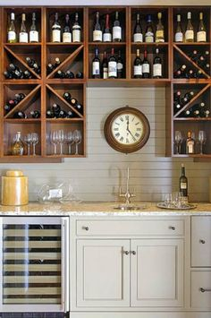 Very practical storage solution, and I like how the darker wood warms up the space.  home bar designs - Google Search