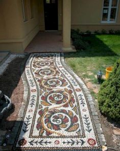 If you're looking for an outdoor project that's a bit off the beaten path, a pebble mosaic will give your yard, garden, or walkway a unique and unexpected focal point. Though the materials to build it are pretty basic—flat pebbles… Continue Reading → Mosaic Walkway, Pebble Mosaic, Stone Mosaic, Mosaic Tiles, Pebble Garden, Garden Stones, Garden Paths, Rocks Garden, Gravel Garden