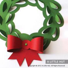 Paper craft. Christmas wreath cutout.