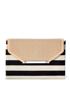 City Slim Clutch - Black/Cream Clean Stripe by Stella & Dot.  Available July 21st!  Use the link in my profile to shop!  Grab this envelope clutch to complement your fav dress or dress it down and wear it cross body by adding our Versatile Chain in silver that also doubles as a necklace! Toss in your cash, cards and lip gloss and you're ready for a chic outing!