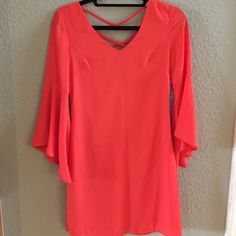 NWOT Coral Dress Pretty coral dress bought at a boutique and never wore! Dresses Mini