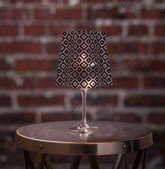Lucy | Wine Glass Shades fit over any standard 12-16 oz (sometimes up to 18oz) wine glass to bring instant elegance to any dinner table, event, wedding or party. Simply drop in the water-activated floating LED candle & enjoy!  Includes 4 shades & 4 candles.  Expandables.ca