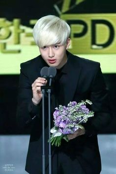 SUHO in suits + his blonde hair = white hot!