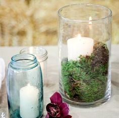 Jars with candles and moss