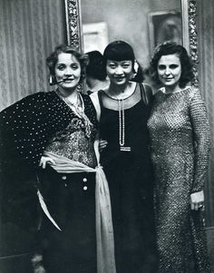 Marlene Dietrich, Anna May Wong andLeni Riefenstahl at theReimann Arts School ball, Berlin, 1928. Photo by Alfred Eisenstaedt.  (Via)