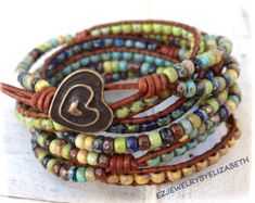ONE OF A KIND SEED BEAD WRAP BRACELET, MULTI COLOR SEED BEAD LEATHER WRAP BRACELET.  YOU HAVE YOUR CHOICE OF MANY BUTTONS. IF THERES AN ITEM WITH A PARTICULAR BUTTON YOUD LIKE ON ANOTHER LEATHER WRAP BRACELET,PLEASE LET ME KNOW.  PLEASE MEASURE YOUR WRIST SIZE BEFORE YOU ORDER THANK YOU FOR STOPPING BY,PLEASE CONTACT ME IF YOU HAVE ANY QUESTIONS.  PLEASE READ MY SHOP POLICIES BEFORE PURCHASE:  CONTACT ME FOR SHIPPING OUTSIDE THE USA