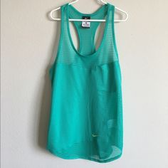 Nike Mesh Tank Gently used, in good condition with no signs of wear. Turquoise tank with mesh paneling and a racerback style top. Nike sign at lower bottom is in a bright yellow color. No trades, offers welcome! Nike Tops Tank Tops