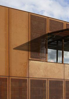 more opaque and perforated corten paneling ------Hackney Marshes Centre by Stanton Williams
