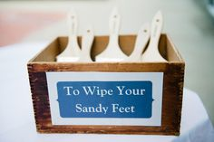 Brushes to wipe off sandy feet for #beach #weddings. Photo by Kate Connolly Photograpy