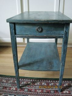 reclaimed black table- milk paint - sky blue, bwon wax and hardware that has been antiqued