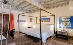 An insider's guide to the best cheap hotels in Rome, including the top affordable places to stay for boutique bedrooms, rooftop terraces, palazzo architecture and a romantic ambience, in locations near to the Colosseum, the Roman Forum and St Peter's Basilica.