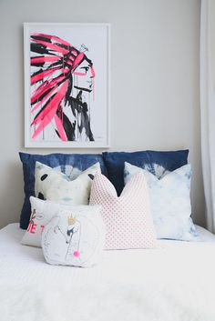 With a pop of neon pink: http://www.stylemepretty.com/living/2015/07/13/modern-all-white-nursery-with-a-pop-of-pink/ | Photography: Claire Esparos - https://www.homepolish.com/