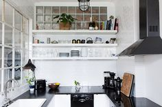 glass walls in the kitchen (via lingered upon)