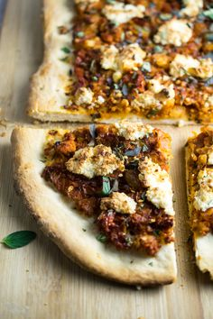 Tender cauliflower braised in spicy tomato sauce, and topped with dollops of almond cream, make this Sicilian cauliflower pizza recipe a treat!