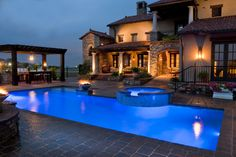 Special features on this Tuscany-inspired project include two Fire & Water bowls, Mosaic tile, and Pavestone decking.