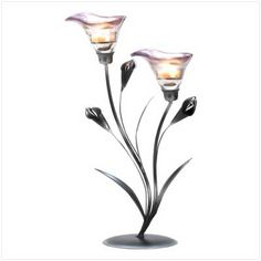 calla lily candleholder   Description  Slender calla lilies in a sophisticated shade of pewter add Art Deco elegance to any room. A glamorous decoration that's gorgeous by day, and entrancing by night when filled with quiet candlelight!